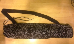 Black yoga bag with white embroidery